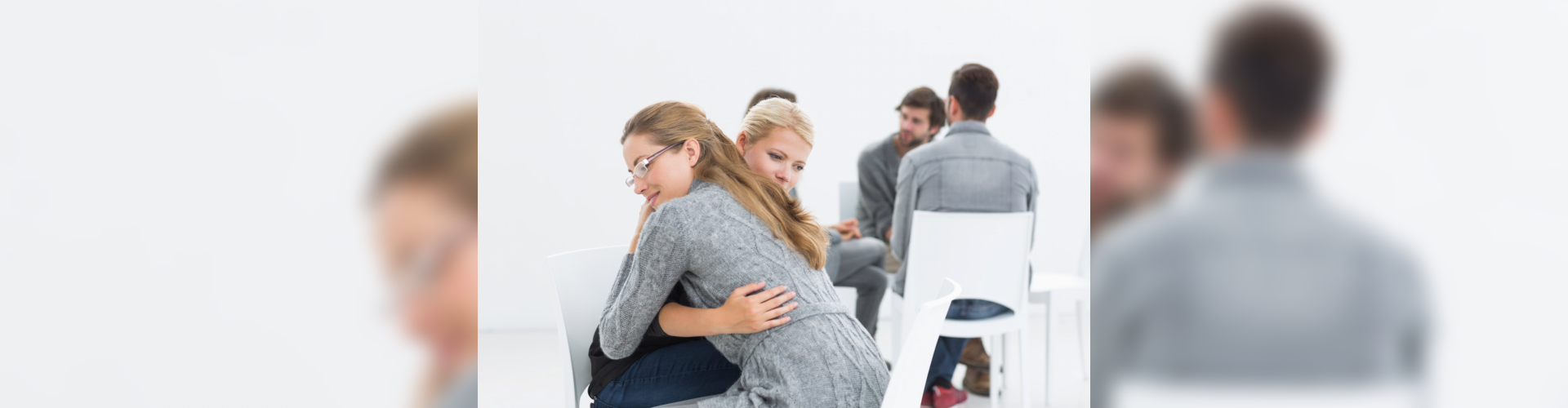 group therapy session therapist client hugging circle foreground