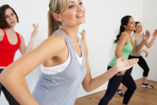 group of women exercising dance studio smiling