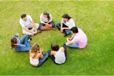 a group of peaople forming circle